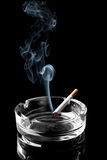 Cigarette on ashtray Stock Photography