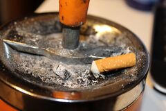 Cigarette on ashtray Royalty Free Stock Image