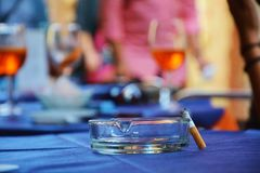 Cigarette and ashtray on blurred background Royalty Free Stock Photography