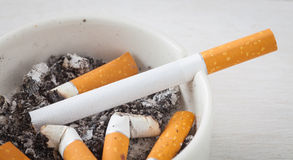 Cigarette and ashtray Royalty Free Stock Photography