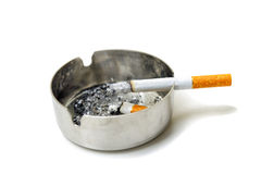 Cigarette and ashtray Stock Photography