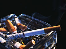 Cigarette in ashtray Royalty Free Stock Image