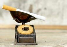 Cigarette on balance Stock Images
