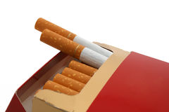 Cigarette box. A cigarette box with two cigarettes sticking out Royalty Free Stock Images
