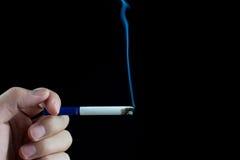 Cigarette brûlante Photo libre de droits