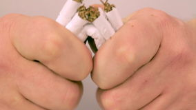 Cigarette break in her hand close-up stock footage