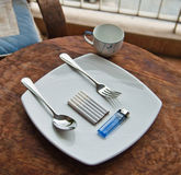 Cigarette breakfast. Favorite breakfast of smoker and white dish Stock Images