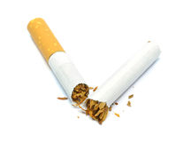 A cigarette broken in half Royalty Free Stock Photos