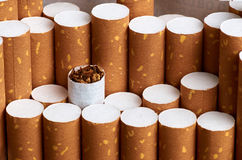 Cigarette with brown filter. Tobacco in cigarettes with brown filter Royalty Free Stock Photography