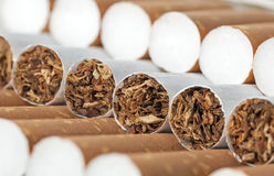 Cigarette with brown filter Royalty Free Stock Images