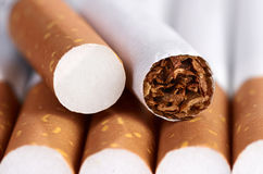 Cigarette with brown filter. Tobacco in cigarettes with brown filter close up Royalty Free Stock Image
