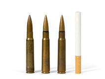 Cigarette and bullets Stock Image