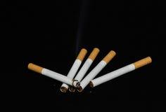 Cigarette burning Stock Image