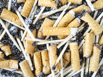 Cigarette burns. Bunch of cigarettes burns and matches Stock Images