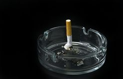 Cigarette butt. In ashtray isolated on black background Stock Photo