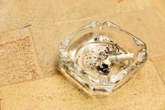 Cigarette butt in ashtray Stock Photography