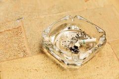 Cigarette butt in ashtray Stock Photography