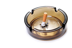 Cigarette butt in ash tray Stock Photo