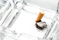 Cigarette butt in ash tray Stock Photography