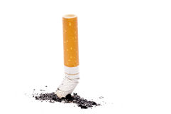 A cigarette butt and ashes on white Stock Image