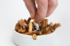 Cigarette butt in an ashtray Stock Images