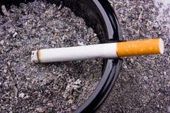 Cigarette in ashtray Stock Photography
