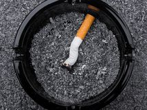 Cigarette butt in ashtray Stock Image