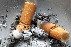 Cigarette butt in the ashtray. Unhealthy life style concept Royalty Free Stock Photos