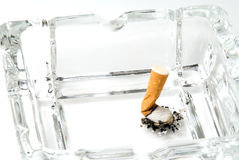 Cigarette butt in ashtray Stock Photos