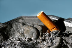 Cigarette butt in ashtray Stock Images