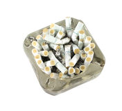 Cigarette. In ashtray isolated on white background royalty free stock photography