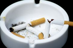 Cigarette butt in ashtray - No smoking Stock Photos