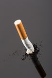 Cigarette butt on gray Royalty Free Stock Photos
