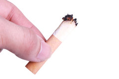 Cigarette butt in hand Royalty Free Stock Photos