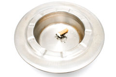 Cigarette butt in a metal ashtray Royalty Free Stock Photos