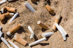 Cigarette in sand royalty free stock photos