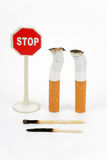 Cigarette butt and sign stop. Isolated on white Stock Photography