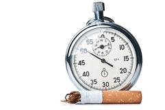 Cigarette butt and stopwatch Royalty Free Stock Image