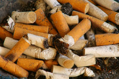 Cigarette butts. A close up shot of cigarette butts Royalty Free Stock Photos