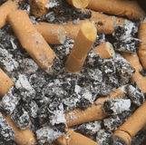 Cigarette Butts. Close-up of ashtray full of cigarette butts Stock Photos