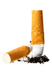 Cigarette butts. Close-up isolated on the white background Stock Photography