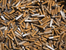 Cigarette butts. As a background Royalty Free Stock Image