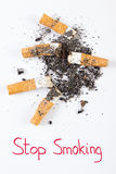 Cigarette butts and ash, stop tobacco save your life Stock Photography
