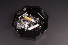 Cigarette butts in an ashtray Royalty Free Stock Image