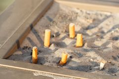 Cigarette butts in a ashtray royalty free stock image