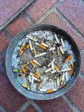 Cigarette Butts in an Ashtray Royalty Free Stock Photos