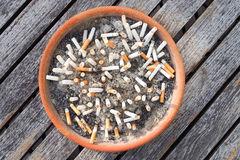 Cigarette butts in the ashtray on wood table background. The concept of World No Tobacco Day in 31 May, stop smoking, do not smoke Stock Photography