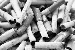 Cigarette Butts Background Royalty Free Stock Photos
