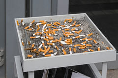 Cigarette butts. In big ashtray Stock Photos