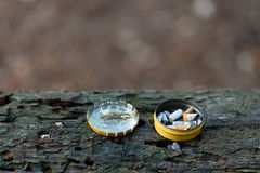 Cigarette butts in box Royalty Free Stock Photos